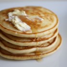 Fluffy Pancakes - Tall, fluffy pancakes are delicious served with butter and syrup or top with strawberries and whipped cream for a real treat.