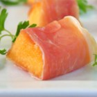 Prosciutto e Melone (Italian Ham and Melon) - This easy and refreshing starter featuring cantaloupe and cured ham (Parma ham for instance) can also be served as an appetizer: just cut the cantaloupe into bite-size pieces, wrap them with ham and spear them on skewers for a colorful snack! Use superior quality Italian ham for best results.