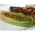 Grilled Romaine - Grilled romaine lettuce is a nice change of pace from just a regular green salad and all you need is steak seasoning, olive oil, and a bit of lemon juice!
