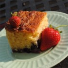 Berry Cornmeal Cake - A variation on a berry cobbler, this baked dessert features blueberries, raspberries, strawberries, and blackberries (or your choice!) with a cornmeal cake topping. Sweetened condensed milk is the secret ingredient.