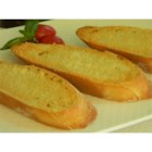Parma Crisps - Perfect with rich soups and stews, these toasted baguette slices with a drizzle of olive oil and a sprinkling of Parmigiano-Reggiano are sure to please.
