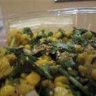 Cauliflower and Arugula Honey Sesame Salad - This unusual salad has seasoned cauliflower and sweet corn tossed with peppery arugula in a lemony parsley dressing. Sesame seeds add a toasty crunch.