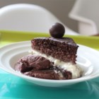 Dark Chocolate Cake I - This recipe features an icing made with cream cheese, cocoa, and cinnamon frosts this dark chocolate cake for an elegant dessert.