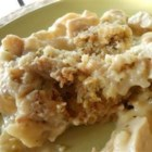 Chicken and Dressing Casserole - Stuffed chicken baked inside out, as cornbread dressing makes a nest for fowl and sauce.