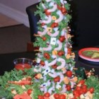 Mary's Christmas Shrimp Tree - Quick, easy, and impressive! Cooked shrimp and other colorful munchies are displayed on a Christmas tree created with beet greens wrapped around a cone shape.