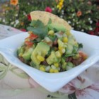 Best Ever Cilantro Corn Salsa - Grilled fresh sweet corn combines with chopped tomatoes, avocado, and cilantro in a light vinaigrette dressing.