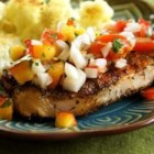 Grilled Pork Chops with Fresh Nectarine Salsa - A summertime salsa livens up spicy, grilled pork chops with sweet-tangy flavors from nectarines and tomatoes sparked by onions, cilantro, chile pepper flakes, and lime juice.