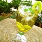 White Sangria with Kiwi - Slices of kiwi fruit add a tropical flavor and color to this not-too-sweet white wine sangria.