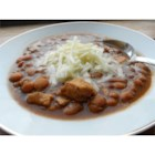Chicken Chili I - Navy beans and chicken are combined in a broth seasoned with cumin, oregano and jalapeno in this soup to serve garnished with grated jack cheese and chopped green onion.