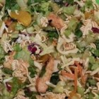 Easy Yummy Chinese Chicken Salad - The cooked dressing is flavorful and easy. And the salad is crunchy and fun. Shredded cabbage, lettuce, noodles, chicken, green onions and almonds. Serves twelve.