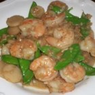 Shrimp with Ginger and Snow Peas - This light, Spring shrimp dish is highly flavored with caramelized onions, ginger, garlic, and cilantro. It's great served over couscous!