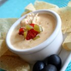 Chili con Queso with Chicken (Similar to Carlos O'Kelly's) - This addictive, creamy, cheesy, and rich hot appetizer dip with Mexican flavors takes only a few minutes to whip up. Serve with tortilla chips.