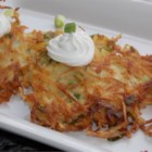 Apple Potato Pancakes - These potato pancakes include shredded apples and green onions for a new twist to the traditional recipe. Top with sour cream.