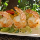 Garlic Grilled Shrimp - Simply seasoned shrimp are brushed with a garlic-infused olive oil as they cook on the grill.