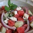 Refreshing Cucumber Watermelon Salad - Watermelon, baby cucumbers, feta cheese, mint, and red onion are tossed together in this summer salad recipe.