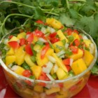 Mauigirl's Mango Salsa - Sweet onion and fresh ginger bring out the tropical flavors of ripe mango in this crowd-pleasing salsa.