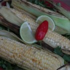 Chili-Lime Grilled Corn-on-the-Cob - Brush ears of sweet corn with a mixture of lime juice seasoned with chili powder and just grill them until golden brown for a light and tasty side dish.