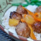 Famous Meatballs - Prepared meatballs simmer in a slow cooker with a sauce made with canned pineapple in juice and green bell pepper for a dish that will be popular at any gathering.