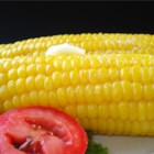 Corn On The Cob (Easy Cleaning and Shucking) - There's no need to husk and silk an ear of corn when you use this quick method for microwaving a whole ear of unhusked corn and just squeezing it out of the husk.