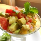 Guacamole Salad - Fresh avocado, tomato, cucumber, and corn are tossed together to make a delicious, crisp salad for a hot summer day!