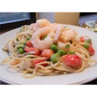 Spaghetti Salad III - Simple, pretty and delicious. Pasta, shrimp, celery, onion and peas, all tossed in a creamy ranch dressing.