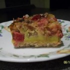 Mom's Rhubarb Custard Torte - Plenty of rhubarb flavors this eggy baked custard torte with a tasty oat crust.