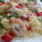 Grilled Shrimp Caprese - Grilled shrimp over angel hair pasta with melted mozzarella, basil, and tomatoes in a garlic butter sauce makes a delicious and easy meal.