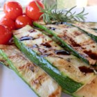 Grilled Zucchini - Long strips of zucchini are basted with a rosemary-accented olive oil mixture and cooked on the grill in this recipe.