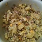 Curried Potato Salad - Curry and apple chunks liven up this cold potato salad, made with sour cream and mayonnaise.