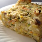 Light Zucchini Casserole - Grated zucchini and onion combined with buttermilk, Parmesan cheese and biscuit mix, and baked in a pie pan. Delicious as a side dish or for brunch.
