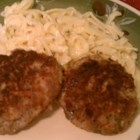 Swabian Meatballs (Fleischkuechle) - These German meat patties use both ground beef and ground pork seasoned with marjoram, parsley, onion, and garlic and are fried in butter.