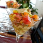 Best Melon, Mango, and Avocado Salad - Tangy pickled onions and creamy avocados add a surprisingly savory bite to this crisp fruit salad. When served in a pretty martini glass, it makes a stunning first course.
