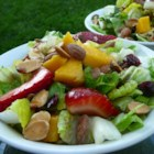 Strawberry-Mango Mesclun Salad - Mango, strawberries, and sweetened dried cranberries are a vibrant addition to mixed greens tossed with an oil and balsamic vinegar dressing.