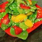 Strawberry Spinach Salad III - Dill is sprinkled on the strawberries and spinach before being tossed in a robust and sweet vinegar and oil dressing laced with hot mustard, onion and garlic powder, and a pinch of cayenne.