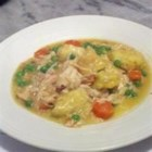 Healthier Slow Cooker Chicken and Dumplings - A meal that practically cooks itself in the slow cooker, these chicken and dumplings are made healthier by adding more vegetables and using natural soup.