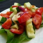 Tomato Cucumber Salad -  Diced tomatoes and cucumbers, chopped onion, and a splash of lemon juice. Chill and serve to four.