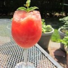 Watermelon Vodka Slush - Watermelon puree is frozen, then blended with vodka, melon liqueur, lemon juice and simple syrup.