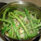 Country Green Beans - Fresh green beans are cooked with bacon, onion, and garlic for a delicious side dish.