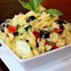 Easy Cold Pasta Salad - A quick and easy cold pasta salad with tomatoes, cucumbers, black olives, and a tangy Italian dressing.