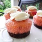 Neapolitan Cupcakes - Tri-colored cupcakes have a layer of chocolate brownie on the bottom, a pink strawberry middle, and vanilla frosting on top.