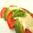Jalapeno Ranch Dressing - Prepared ranch dressing is given a boost through the addition of cilantro, jalapeno peppers, tomato, and avocado. Just blend and chill.