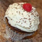 """Zuccotto"" Cupcakes - These whipped cream- and raspberry-filled cupcakes are coated with two different frostings: a dark chocolate ganache and a white chocolate-cream cheese icing. They're inspired by the classic dome-shaped Italian cake."