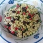 Spicy Corn and Black Bean Salad - Corn kernels pan-fried with fajita seasoning are tossed with black beans, jalapeno, and lime and orange juice for a tangy and spicy salad.
