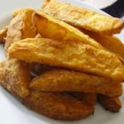 Mojo French Fries - Oven-baked potato wedges coated in flour with spicy seasonings are a nice alternative to French fries.