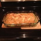 Cheesy Chicken Florentine - Chicken breasts are nestled in a spinach souffle enhanced with Swiss cheese and rice.