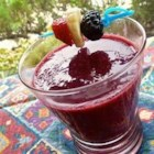 4th of July Blast Smoothie - Ice-cold, slushy glasses of blackberry and banana smoothie are topped with fresh blackberries for a summertime treat.