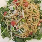 Lemon Coconut Thai-Inspired Pasta - A refreshing Thai-inspired twist is added to pasta with a coconut milk and basil-based sauce, tossed with spaghetti, tomatoes, and green onions.