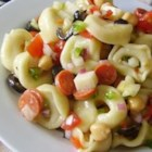 Tortellini Salad - An easy and delicious cold pasta salad tastes like an Italian antipasto platter, with cheese tortellini, olives, pepperoni, mozzarella cheese, and marinated artichoke hearts.
