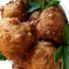 Curried Corn Fritters - Delicious corn fritters that can easily be whipped up in an instant. Great with yogurt-mint sauce, or as 'bread' for a tomato, pepper, and basil sandwich.