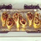Chef John's Stuffed Summer Squash - Summer squash paired with Merguez sausage and goat cheese is the perfect recipe for a summer evening.